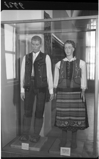 "Image 8 MAPc-1266 | The Museum of Folk Art: aspects from the museum halls – showcase with mannequins displaying Serbian folk clothes from Banat region, Moldova Nouă area, Timișoara region, 6 × 9 cm, registered on the 17th of November 1954. Photographer: Studio ""Stătescu"". Folk Art Museum (MAP) collection"